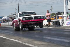 Drag racing. Front view of plymouth barracuda drag car making a wheelie Royalty Free Stock Photos