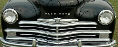 Plymouth car front grill black chrome. Plymouth car front grill parked in frontal view royalty free stock photography