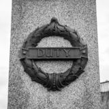 Plymouth City War Memorial Wreath with Duty Plaque. Plymouth, England - Sep 12, 2018: Plymouth City War Memorial Wreath with Duty Plaque, Shallow Depth of Field royalty free stock images