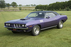 Cuda. St liboire august 2, 2014 front side view of in violet 1971 plymouth cuda convertible with 426 hemi engine and black vinyl top at mopar convention Royalty Free Stock Images