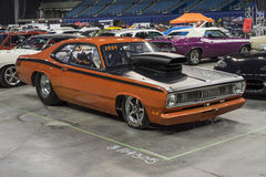 Plymouth duster. Montreal october 10-12, 2014 picture of orange plymouth duster drag car in display during the autorama event Royalty Free Stock Photo