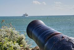 Large Canon Aimed at Passenger Ferry in Plymouth Harbor England stock image