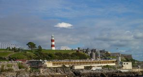 Plymouth in England with lighthouse at background. Stock Images