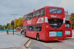 Red double decker bus in Plymouth City stock image