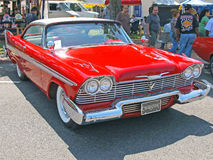 1957 Plymouth Fury. This is a two tone red and white 1957 Plymouth Fury made famous in the Stephen King novel 'Christine stock photography