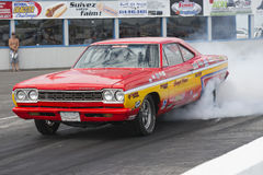 Drag racing. Napierville dragway july 12, 2014 picture of plymouth drag car making smoke show at the starting line during nhra national open event Stock Photography