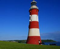 Smeaton's Tower Red and White Lighthouse. Smeaton's Tower is a Eddystone Lighthouse in the UK, rebuilt on Plymouth Hoe in the city of Plymouth, Devon Royalty Free Stock Photos