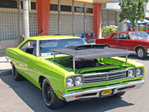 Plymouth Road Runner. This is a customized. lime green Plymouth Road Runner with an after market hood, including a working air scoop stock photo