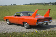 Plymouth road runner superbird. Picture of orange 1970 plymouth road runner superbird with black vinyl top and rallye wheel royalty free stock photos