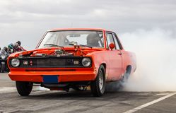 Plymouth Valiant Signet. Photo from a drag racing in Iceland 29.06.2013 of a 1969 Plymouth Valiant Signet muscle car burnout Stock Photos