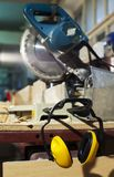 Plywood circular saw and protective earphones Stock Photo