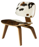 Plywood and cowhide chair. Plywood chair with cowhide seat and back, studio shot Stock Photo