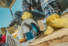 Plywood Cut by Circular Saw. Construction Worker and the Woodworking royalty free stock images