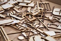 Plywood cut by laser. Plywood cut by the laser in the production of small houses Royalty Free Stock Photo