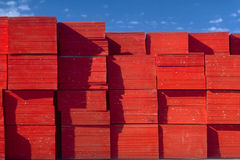 Plywood Ends. Stacks of plywood showing red painted ends stock image