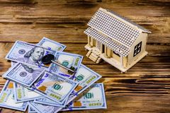 Plywood model of the house, key and one hundred dollar banknotes. Loan, real estate concept. Plywood model of house, key and one hundred dollar banknotes. Loan royalty free stock image