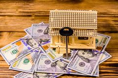Plywood model of the house, key and one hundred dollar banknotes. Loan, real estate concept. Plywood model of house, key and one hundred dollar banknotes. Loan stock photos