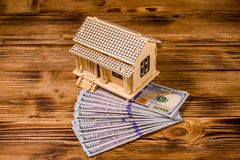 Plywood model of the house and one hundred dollar banknotes. Loan, real estate concept. Plywood model of house and one hundred dollar banknotes. Loan, real royalty free stock photos