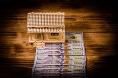 Plywood model of the house and one hundred dollar banknotes. Loan, real estate concept. Plywood model of house and one hundred dollar banknotes. Loan, real royalty free stock image