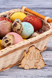 Plywood rabbits and Easter basket. Royalty Free Stock Photography