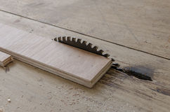 Plywood on table saw for cutting Stock Images
