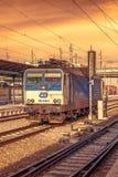 Plzen, Czech Republic - Februar 25, 2017 - Blue and gray electric locomotive at sunset. Sky Stock Photography