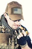 PMC contractor smoking a cigar Stock Image