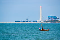 PMY Beach Rayong. Fishermen are fishing at the beach near Rayong factory Royalty Free Stock Images