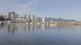 PN Great sunny day - Science world, mountains and skytrain stock video footage