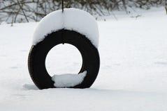 pneu d'oscillation de neige Photographie stock