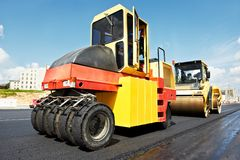 Pneumatic asphalt roller at work Royalty Free Stock Image