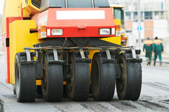Pneumatic asphalt roller at work Stock Photography
