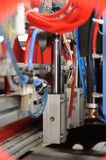 Pneumatic cylinder. Closeup of a production line equipment with pneumatic cylinder in front stock photos