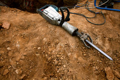 Pneumatic hammer lying on the  Royalty Free Stock Photography