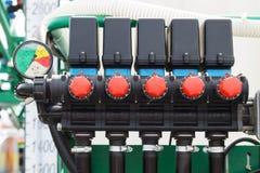 Pneumatic hoses control. Pneumatic controls hoses pressure regulators close-up stock images