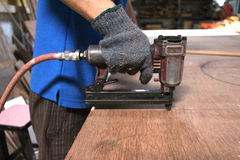 Pneumatic nail gun Stock Images