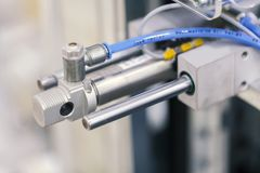 Pneumatic Piston Unit On Industrial Machine Royalty Free Stock Photos