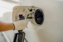 Pneumatic rivet gun installs on a body car stock photography