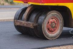 Pneumatic tyred roller compactor at asphalt road Royalty Free Stock Photo