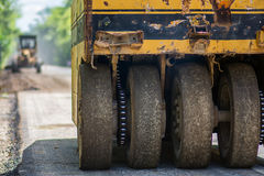 A pneumatic tyred roller. Static compaction using a pneumatic tyred roller Stock Image