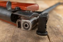 A pneumatic weapon on a wooden table on a shooting range. Shooting accessories needed for shooting sports royalty free stock photos