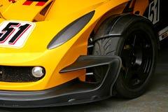 Pneumatico giallo della parte anteriore della macchina da corsa Immagine Stock Libera da Diritti