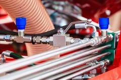 Pneumatiskt hydrauliskt maskineri som g?ras av st?lcloseupen fotografering för bildbyråer