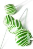 PNF verdes e brancos do lolly dos doces fotografia de stock royalty free