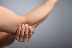 Pnful Elbow Injury. Stock Image