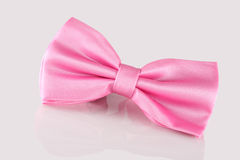 Pnk bow tie close up. Pink bow tie close up on white background Stock Image
