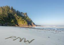PNW i sand på Stillahavskusten arkivbilder