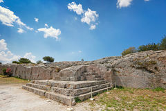 The Pnyx with the bema, Greece. The Pnyx (507 B.C.) with the carved steps of the speaker's platform (bema)  near the Athenian Acropolis, Greece. Pericles Stock Photo