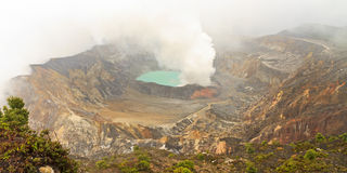 Poás Volcano Crater Lake. Fumarolic activity at the crater lake at the Poás Volcano in the Cordillera Central range in Costa Rica Stock Image