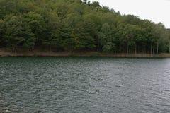 Počúvadlo - Lake. Počúvadlo is a village and municipality in Banská Štiavnica District, in the Banská Bystrica Region of Slovakia stock photo